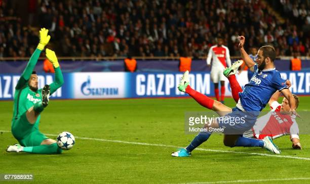 Gonzalo Higuain of Juventus scores his sides second goal during the UEFA Champions League Semi Final first leg match between AS Monaco v Juventus at...