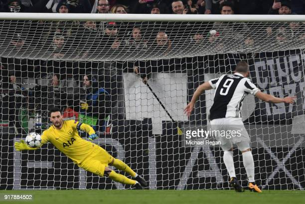 Gonzalo Higuain of Juventus scores his sides second goal past Hugo Lloris of Tottenham Hotspur during the UEFA Champions League Round of 16 First Leg...