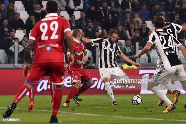 Gonzalo Higuain of Juventus scores his team's third goal during the Serie A match between Juventus and Spal on October 25 2017 in Turin Italy