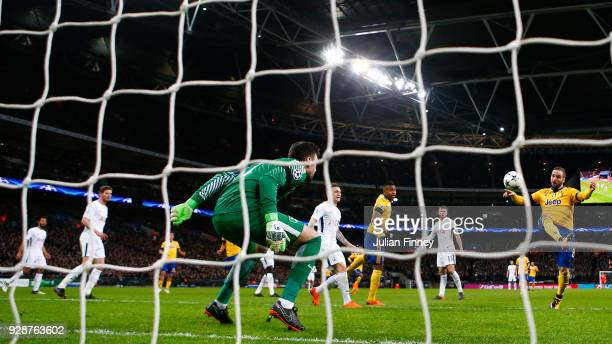 Gonzalo Higuain of Juventus scores the equalising goal during the UEFA Champions League Round of 16 Second Leg match between Tottenham Hotspur and...