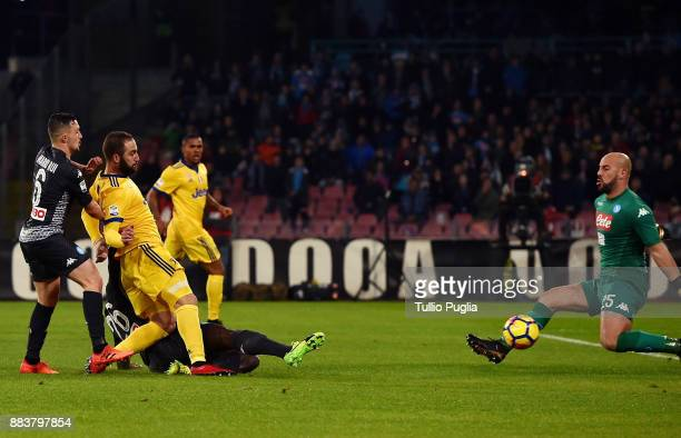 Gonzalo Higuain of Juventus scores the opening goal during the Serie A match between SSC Napoli and Juventus at Stadio San Paolo on December 1 2017...