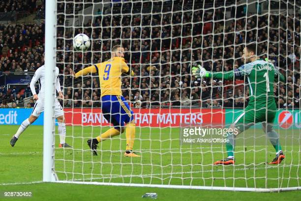 Gonzalo Higuain of Juventus scores their 1st and equalising goal during the UEFA Champions League Round of 16 Second Leg match between Tottenham...