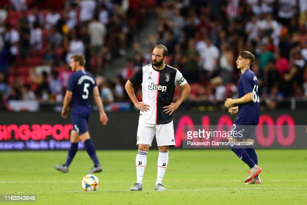 Gonzalo Higuain of Juventus shows dejection after Tottenham Hotspur's third goal during the International Champions Cup match between Juventus and...