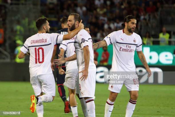 Gonzalo Higuain of Milan celebrates his goal 11 during the serie A match between Cagliari and AC Milan at Sardegna Arena on September 16 2018 in...
