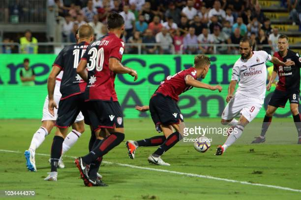Gonzalo Higuain of Milan in action during the serie A match between Cagliari and AC Milan at Sardegna Arena on September 16 2018 in Cagliari Italy