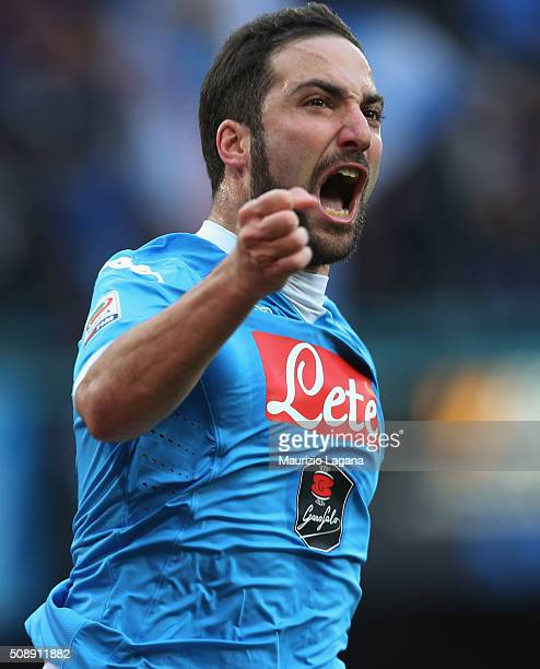 Gonzalo Higuain of Napoli celebrates after scoring the opening goal during the Serie A match between SSC Napoli and Carpi FC at Stadio San Paolo on...