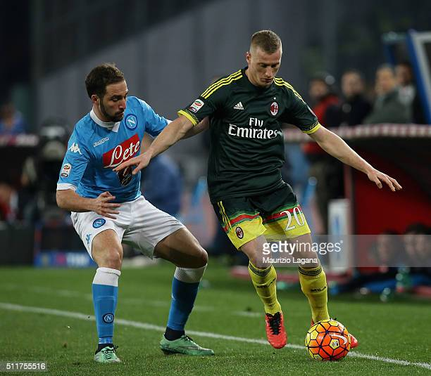Gonzalo Higuain of Napoli competes for the ball with Ignazio Abate of Milan during the Serie A between SSC Napoli and AC Milan at Stadio San Paolo on...