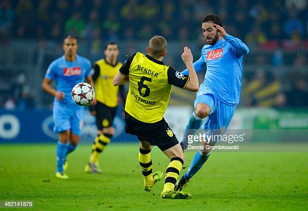 Gonzalo Higuain of Napoli is tackled by Sven Bender of Dortmund during the UEFA Champions League Group F match between Borussia Dortmund and SSC...