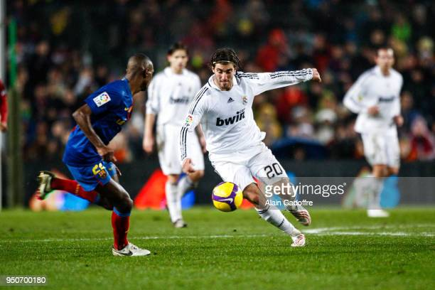 Gonzalo Higuain of Real Madrid and Eric Abidal of Barcelona during the Liga match between Barcelona and Real Madrid at Camp Nou Barcelona Spain on...
