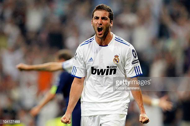 Gonzalo Higuain of Real Madrid celebrates after scoring during the UEFA Champions League Group G match between Real Madrid and Ajax at Estadio...