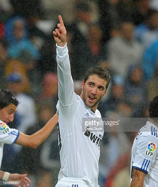 Gonzalo Higuain of Real Madrid celebrates after scoring Real's fourth goal during the La Liga match between Real Madrid and Deportivo La Coruna at...