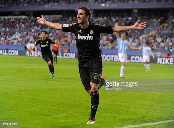 Gonzalo Higuain of Real Madrid celebrates after scoring Real's opening goal during the La Liga match between Malaga CF and Real Madrid CF at Estadio...