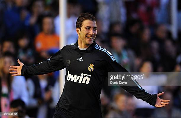 Gonzalo Higuain of Real Madrid celebrates after scoring Real's second goal during the La Liga match between Racing Santander and Real Madrid at El...