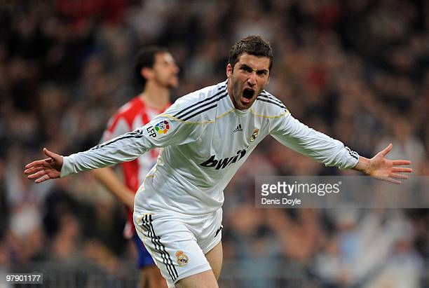 Gonzalo Higuain of Real Madrid celebrates after scoring Real's third goal during the La Liga match between Real Madrid and Sporting Gijon at Estadio...