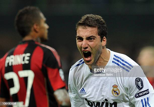 Gonzalo Higuain of Real Madrid celebrates after scoring the opening goal during the Uefa Champions League group G match between Milan and Real Madrid...