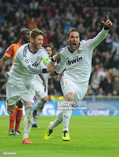 Gonzalo Higuain of Real Madrid celebrates his team's third goal with Sergio Ramos during the UEFA Champions League Quarter Final first leg match...