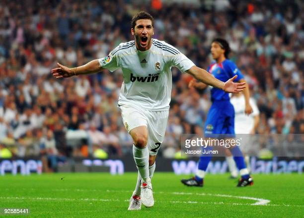 Gonzalo Higuain of Real Madrid celebrates scoring his sides opening goal during the La Liga match between Real Madrid and Getafe at Estadio Santiago...