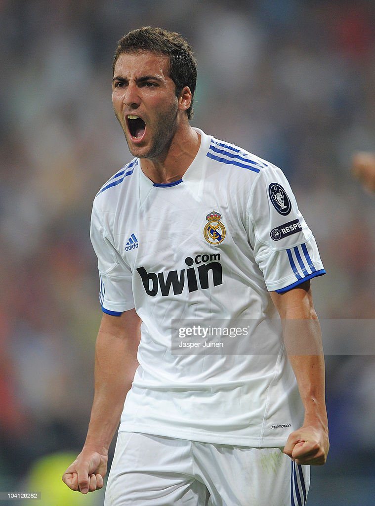 Gonzalo Higuain of Real Madrid celebrates scoring his sides second goal during the UEFA Champions League group G match between Real Madrid and Ajax at the Estadio Santiago Bernabeu on September 15, 2010 in Madrid, Spain.