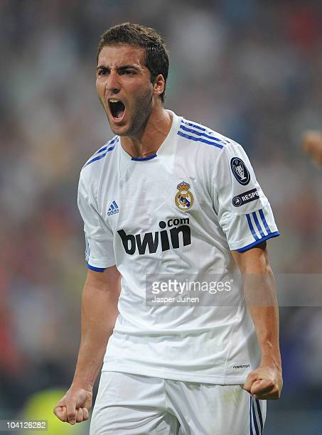 Gonzalo Higuain of Real Madrid celebrates scoring his sides second goal during the UEFA Champions League group G match between Real Madrid and Ajax...