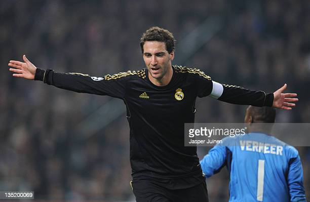 Gonzalo Higuain of Real Madrid celebrates scoring his sides second goal during the UEFA Champions League group D match between AFC Ajax and Real...