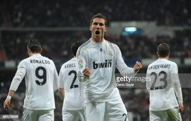 Gonzalo Higuain of Real Madrid celebrates scoring Real's first goal during the La Liga match between Real Madrid and Valencia at Estadio Santiago...