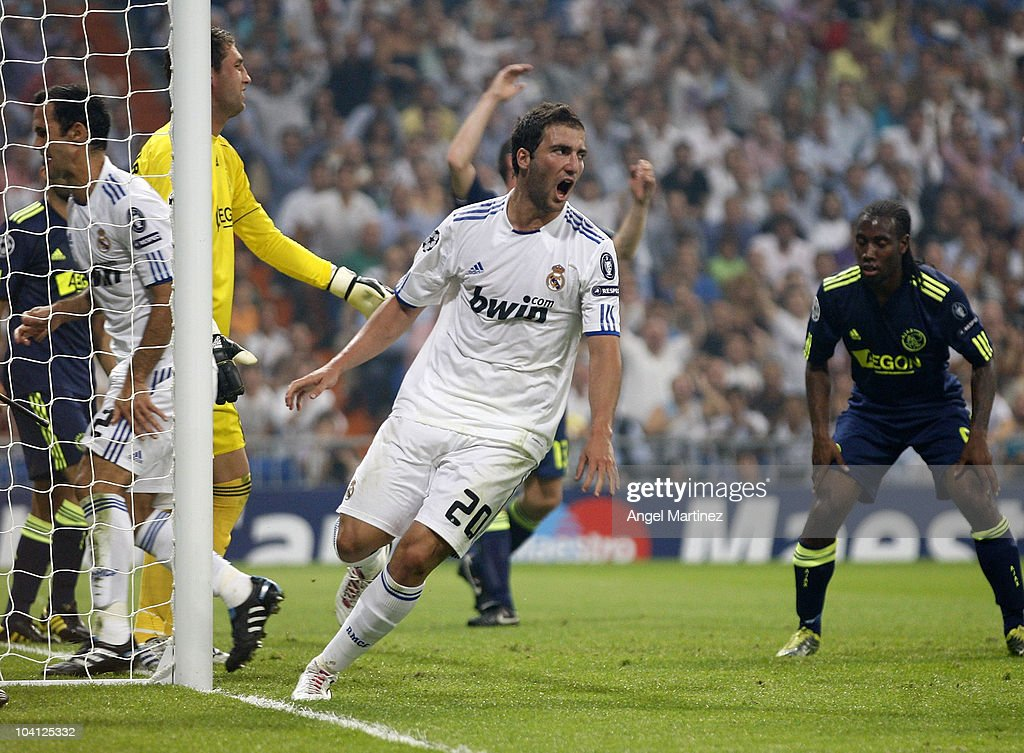 Gonzalo Higuain of Real Madrid celebrates scoring Real's opening goal during the UEFA Champions League group G match between Real Madrid and AFC Ajax at Estadio Santiago Bernabeu on September 15, 2010 in Madrid, Spain.