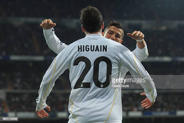Gonzalo Higuain of Real Madrid celebrates with Cristiano Ronaldo after scoring Real's first goal during the La Liga match between Real Madrid and...