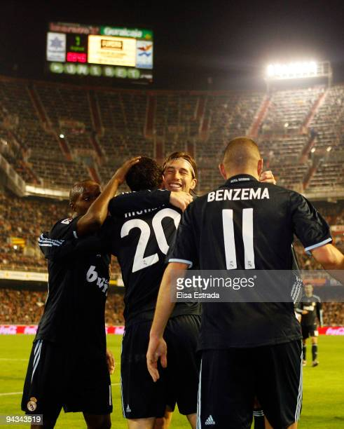 Gonzalo Higuain of Real Madrid celebrates with Karim Benzema Sergio Ramos and Lassana Diarra during the La Liga match between Valencia and Real...