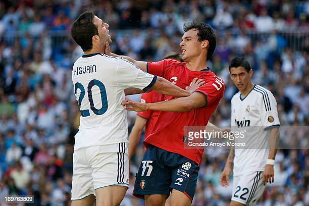 Gonzalo Higuain of Real Madrid CF argues with Unai Garcia of CA Osasuna after a fault during the La Liga match between Real Madrid CF and CA Osasuna...