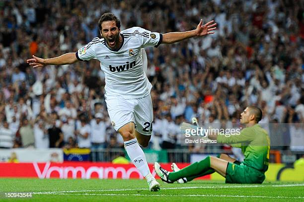 Gonzalo Higuain of Real Madrid CF celebrates after scoring the opening goal during the Super Cup second leg match betwen Real Madrid and FC Barcelona...
