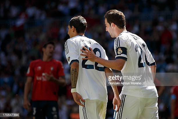 Gonzalo Higuain of Real Madrid CF celebrates scoring the opening goal with teammate Angel Di Maria during the La Liga match between Real Madrid CF...