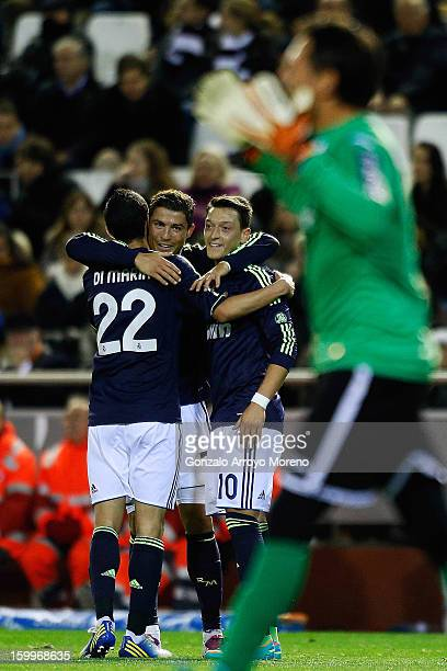 Gonzalo Higuain of Real Madrid CF celebrates scoring their first goal with teammates Mezut Ozil and Angel Di Maria during the La Liga match between...