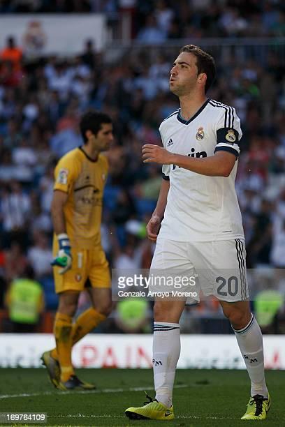 Gonzalo Higuain of Real Madrid CF celebrates scoring their opening goal during the La Liga match between Real Madrid CF and CA Osasuna at Estadio...
