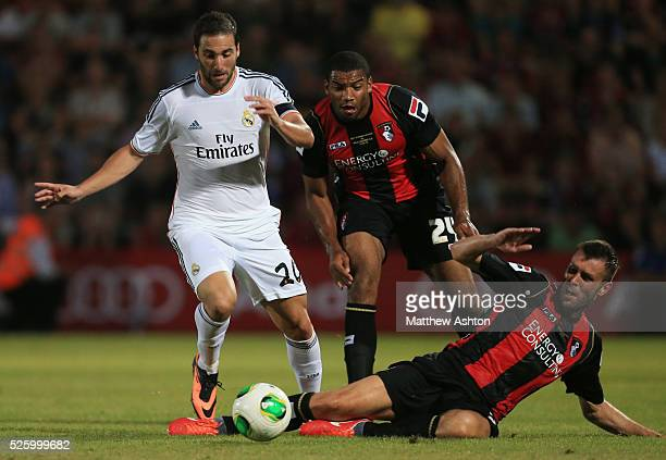 Gonzalo Higuain of Real Madrid gets past Miles Addison and Elliot Ward of Bournemouth