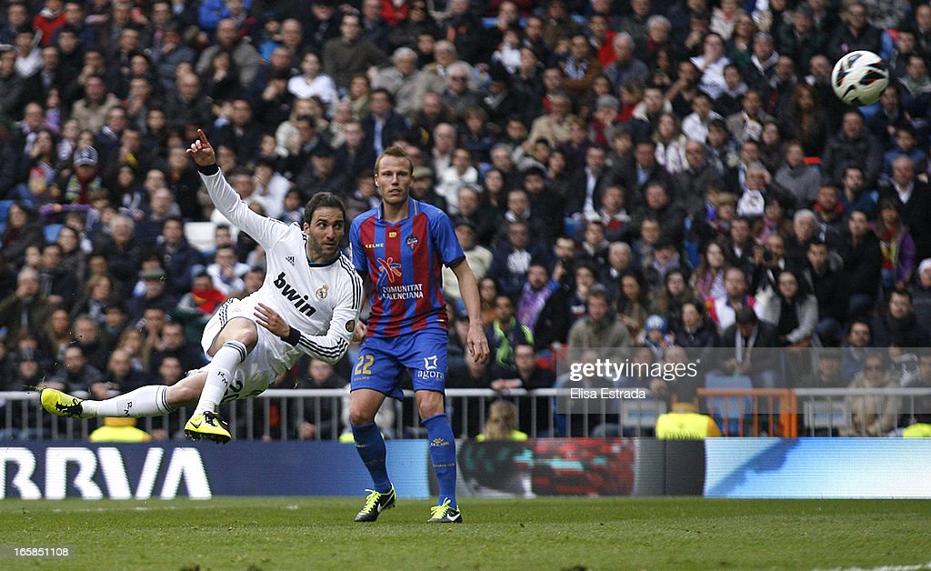 Gonzalo Higuain of Real Madrid scores during the La Liga match between Real Madrid and Levante at Estadio Santiago Bernabeu on April 6, 2013 in Madrid, Spain.