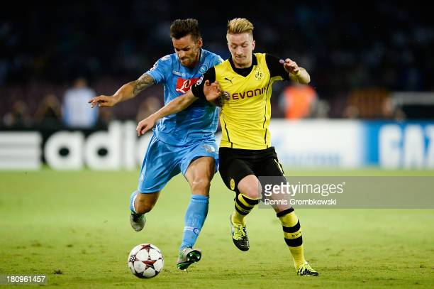 Gonzalo Higuain of SSC Napoli and Marco Reus of Borussia Dortmund battle for the ball during the UEFA Champions League Group F match between SSC...
