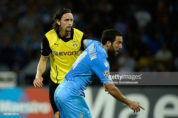 Gonzalo Higuain of SSC Napoli celebrates after heading his team's first goal during the UEFA Champions League Group F match between SSC Napoli and...