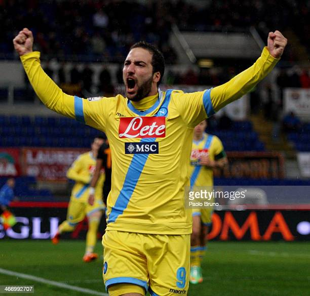 Gonzalo Higuain of SSC Napoli celebrates after his shot deflected off goalkeeper Morgan De Sanctis of AS Roma to score their first goal during the...