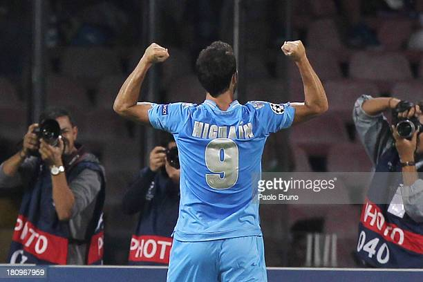 Gonzalo Higuain of SSC Napoli celebrates after scoring the opening goal during the Uefa Champions League Group F match between Napoli and Borussia...