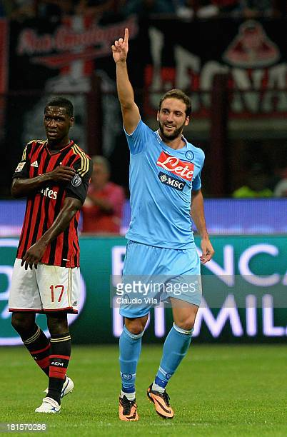 Gonzalo Higuain of SSC Napoli celebrates scoring their second goal during the Serie A match between AC Milan and SSC Napoli at San Siro Stadium on...