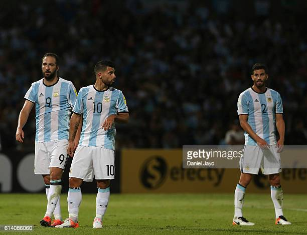 Gonzalo Higuain Sergio Aguero and Mateo Musacchio of Argentina leave the field during a match between Argentina and Paraguay as part of FIFA 2018...