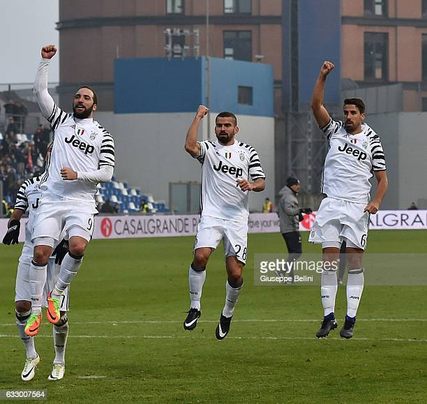Gonzalo Higuain Tomas Rincon and Sami Khedira of Juventus FC celebrate the victory after the Serie A match between US Sassuolo and Juventus FC at...