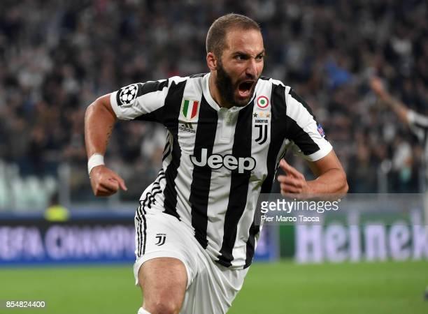 Gonzalo Higuainn of Juventus FC celebrates his first goal during the UEFA Champions League group D match between Juventus and Olympiakos Piraeus at...