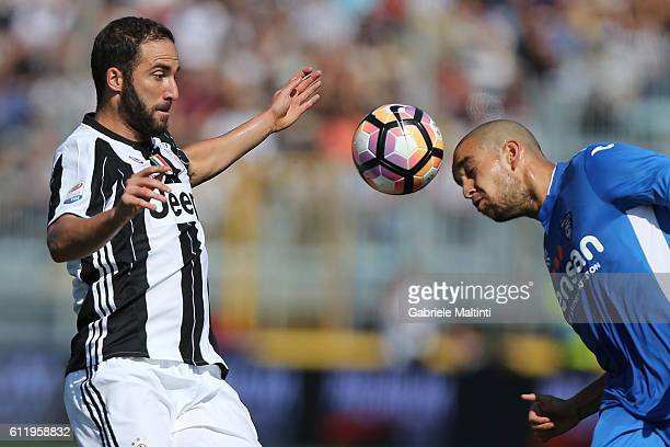 Gonzalo Higuian of Juventus FC against Giuseppe Bellusci of Empoli Fc during the Serie A match between Empoli FC and Juventus FC at Stadio Carlo...
