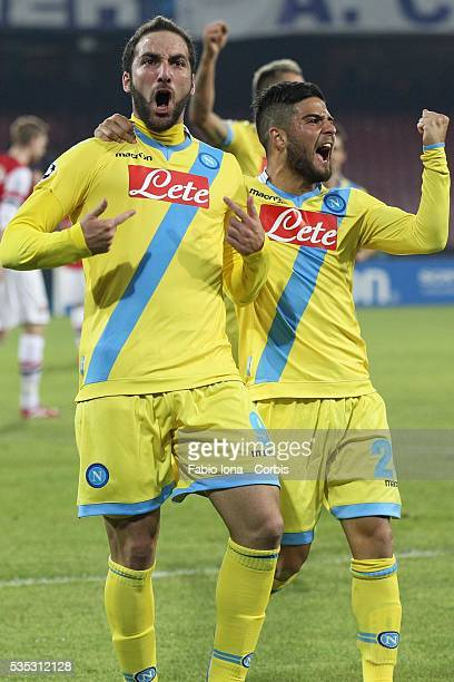 Gonzalo Iguain of Napoli celebrates after scoring the opening goal the UEFA Champions League Group F match between SSC Napoli and Arsenal at Stadio...