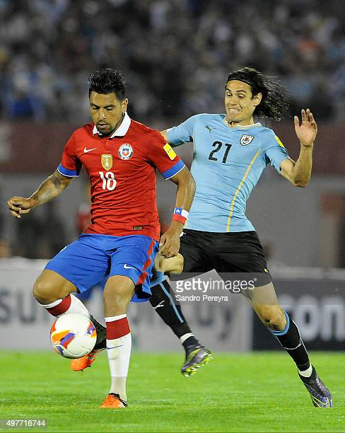 Gonzalo Jara of Chile and Edinson Cavani of Uruguay fight for the ball during a match between Uruguay and Chile as part of FIFA 2018 World Cup...