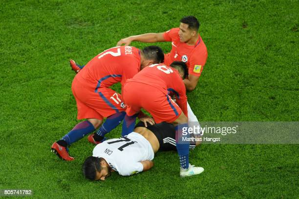 Gonzalo Jara of Chile and Gary Medel of Chile attempt to grab the ball from Emre Can of Germany legs during the FIFA Confederations Cup Russia 2017...