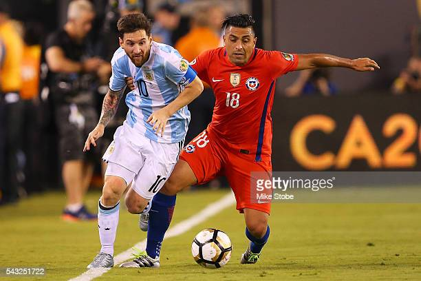 Gonzalo Jara of Chile and Lionel Messi of Argentina vie for the bal during the Copa America Centenario Championship match at MetLife Stadium on June...