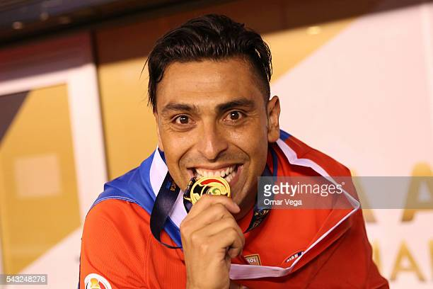 Gonzalo Jara of Chile bites his medal after wining the championship match between Argentina and Chile at MetLife Stadium as part of Copa America...