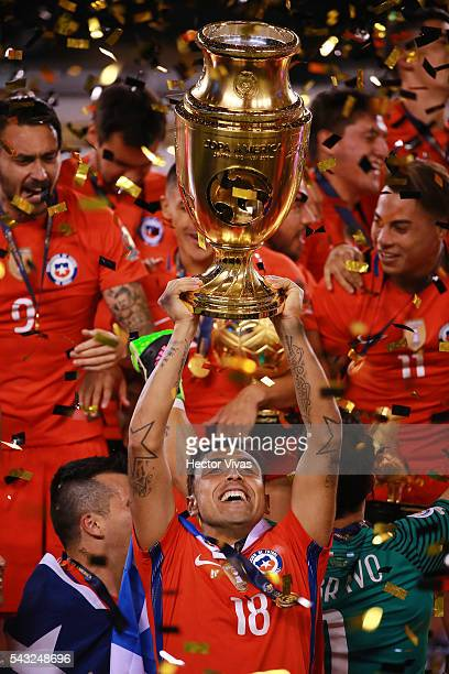 Gonzalo Jara of Chile celebrates with the trophy after winning the championship match between Argentina and Chile at MetLife Stadium as part of Copa...